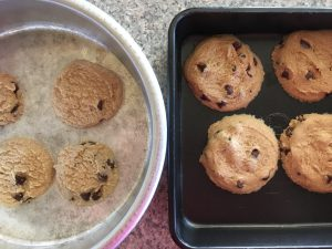 SolarCooker_Cookies baked in an aluminum pan were pale and undercooked, as compared with those baked at the same time on a dark baking sheet