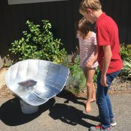 Solar cooking is easy summer fun with a windshield shade