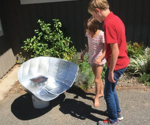 SolarCooker_Isaiah and Karah check out what's baking in the solar oven
