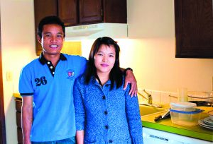The Chin family, from Burma, move into their new apartment.