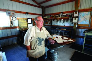 A retired but not idle pressman Tony Sittner is surrounded in his Lewiston garage with printing equipment as old as the late 1890's, all of which still works.