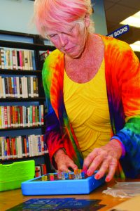 """Lynda Albrecht plays with a Lite Brite toy during """"Timewarp Tuesday"""" at the Moscow Library.  The event allowed adults to relive some of their childhoods with a number of toys."""