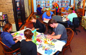 """Participants relive their childhoods by playing with a number of toys during the Latah County Library's """"Timewarp Tuesday"""" event in Moscow August 23."""