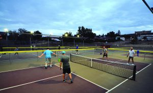 The pickleball action heats up on the courts at Sunset Park as the dusk settle in over Lewiston.