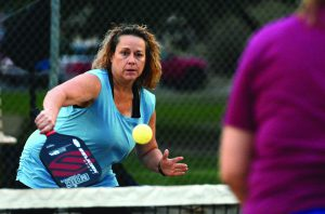 Jennifer Hadley retunrs serve as she starts a pickleball match. Pickleball have proven to be an all ages sport as yound and old are picking up the activity.
