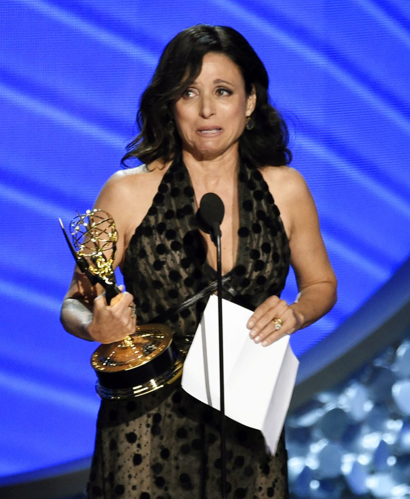 "Julia Louis-Dreyfus accepts the award for outstanding lead actress in a comedy series for ""Veep"" at the 68th Primetime Emmy Awards on Sunday, Sept. 18, 2016, at the Microsoft Theater in Los Angeles. (Photo by Chris Pizzello/Invision/AP)"