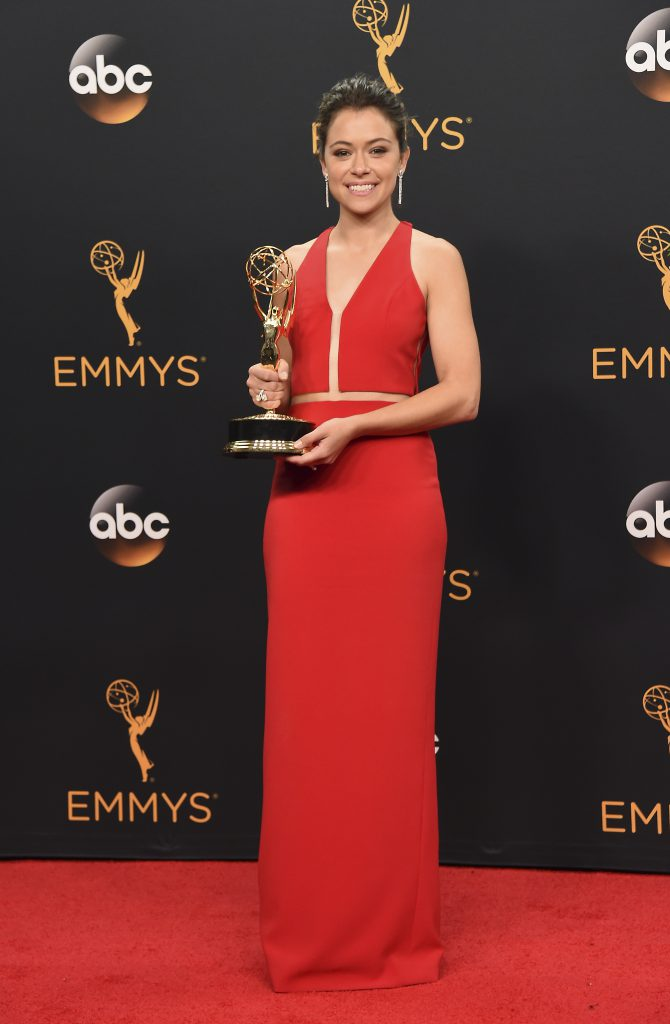 "Tatiana Maslany winner of the award for outstanding lead actress in a drama series for ""Orphan Black"" poses in the press room at the 68th Primetime Emmy Awards on Sunday, Sept. 18, 2016, at the Microsoft Theater in Los Angeles. (Photo by Jordan Strauss/Invision/AP)"