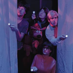 "The Regional Theatre of the Palouse production of  ""Scooby-Doo and the Abandoned Mansion"" features (clockwise from left) Garret McClure as Shaggy, Megan Bloom as Daphney, Jasper Barbosa Rodriguez as Fred and Alyssa Dalbeck as Velma. Alma Robles as Scooby Doo is at center."