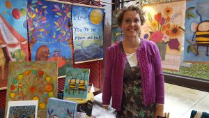 Julene Ewert of Moscow creates colorful prints that adorn everything from banners to postcards.