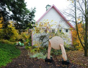 "The Little Pink House Gallery is located behind Vieth's Genesee home. The current exhibit, ""West,"" features outdoor sculpture by Uniontown artist Len Zioli."