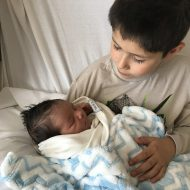 Big brother holding baby brother